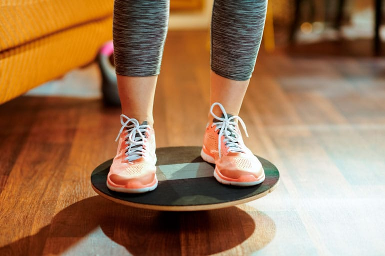 woman is exercising on balance board