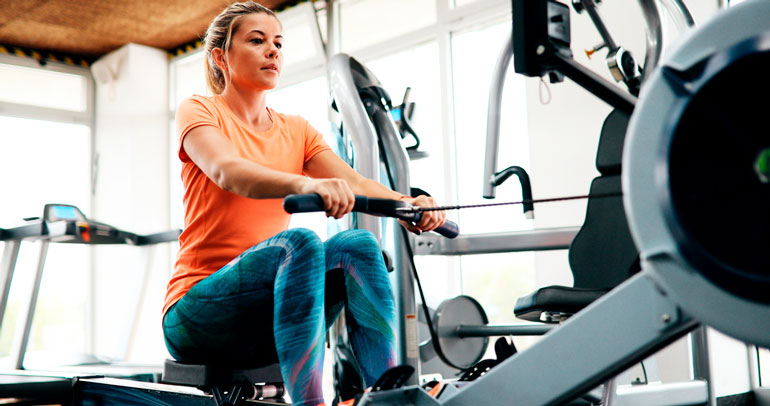 woman is exercising on rowing machine