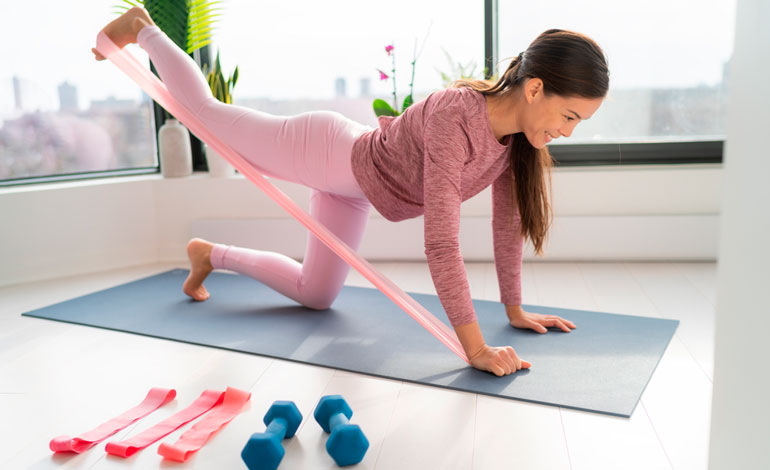 woman is exercising with resistance band