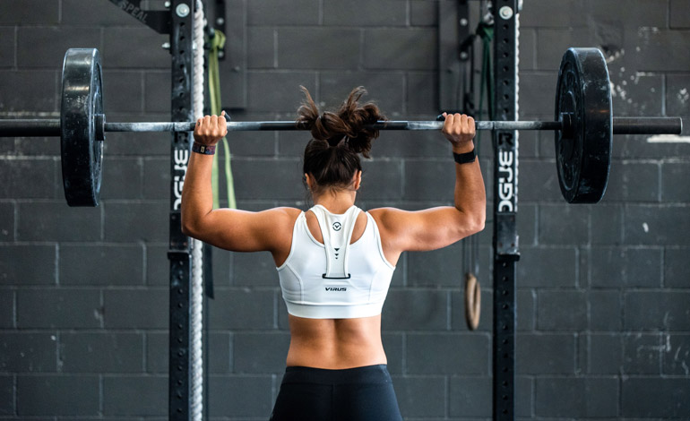 woman is lifting barbell