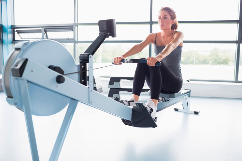 woman is performing rowing motion