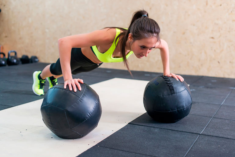 woman is working out with medicine ball
