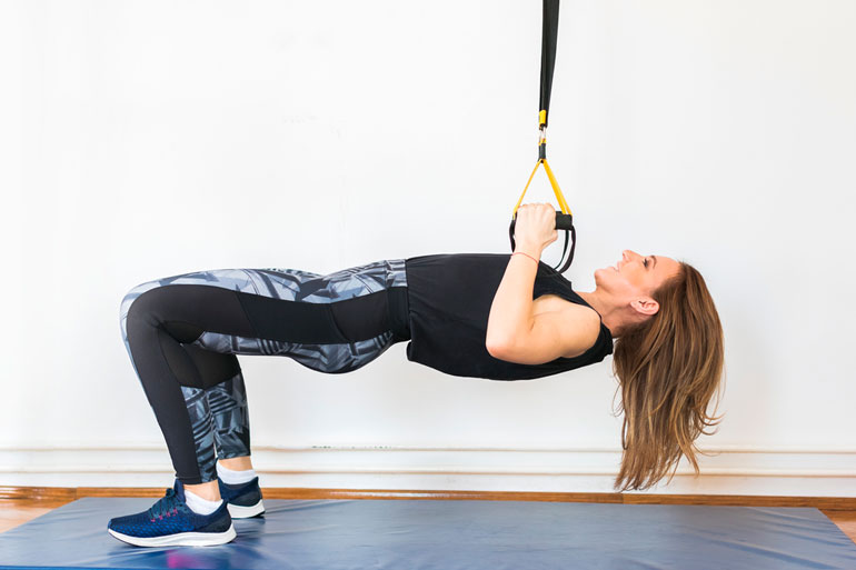 woman is working out with sustainable bands