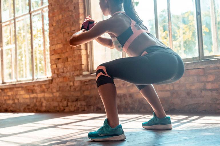 woman performing Air Squat at home