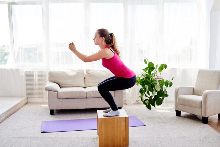 woman performing Box Jump Squats