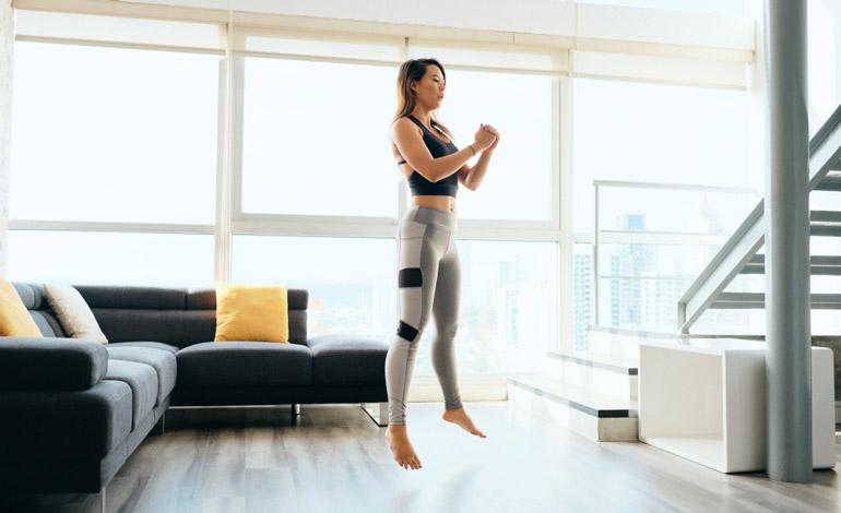woman performing Jump Squats at home