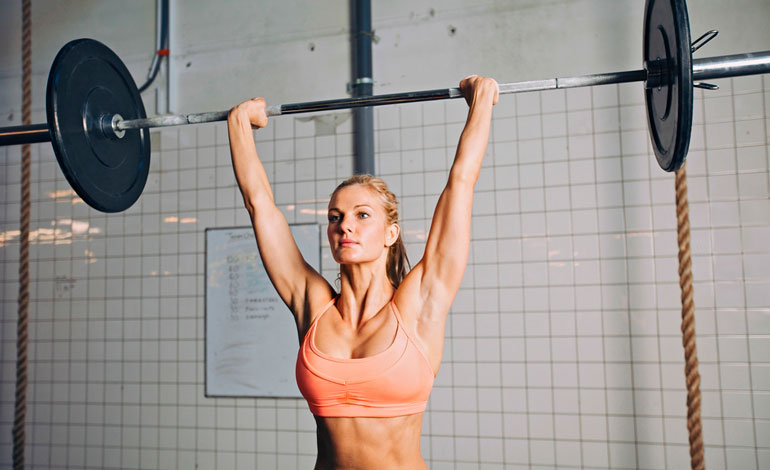 woman performing Overhead Press