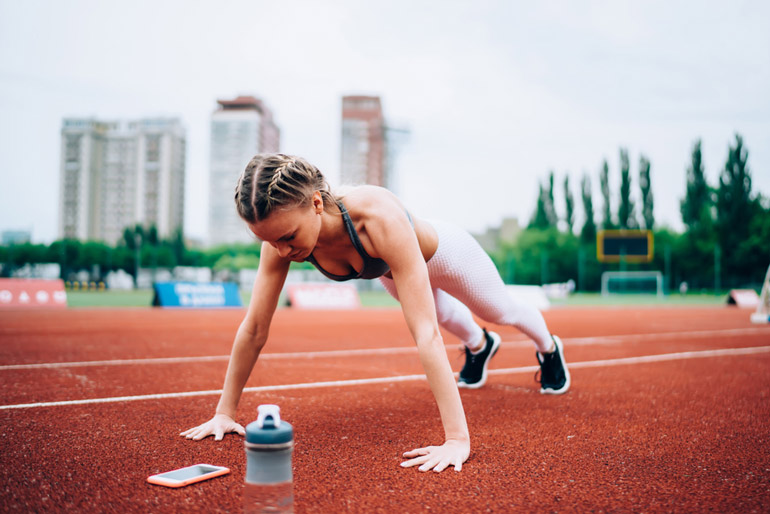 woman performing Squat Thrusts