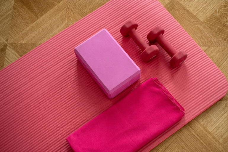 yoga essentials mat dumbbells and blocks